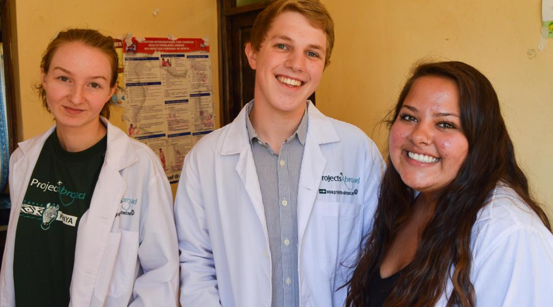 A group of high school students doing a medicine internship take a break between shifts at a clinic in Kenya.